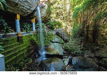 Amazing  Thailand The Temple Under Waterfall Wat Tham Heo Sin Chai Waterfall. Kaeng Tana National Pa