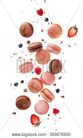 Fly French Macarons. Levitate Composition With Different Types Colorful Macaroons In Motion Falling