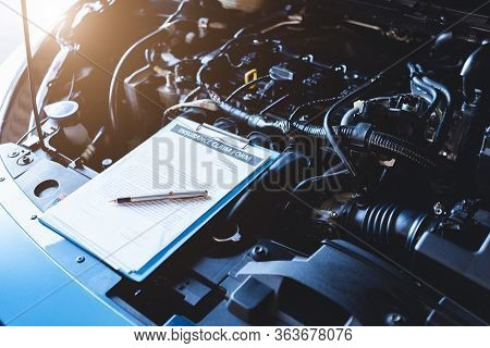 Clipboard On Car With Car Insurance Claim Form For Customer Maintenance Vehicle Checklist In Auto Re