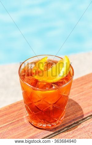 Negroni Cocktail Near A Pool At The Resort Bar Or Suite Patio. Luxury Resort, Vacation, Holiday, Get