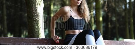 Girl Doing Stretching Muscles Leaning On Bench. Girl Increases Working Capacity Learns To Use For Al