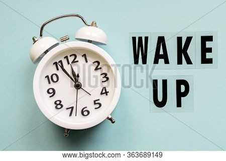 Wake Up Inscription. Alarm Clock With Wake Up Text On Blue Background