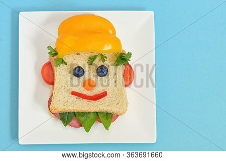 Creative Children's Breakfast With Smile Worker Face