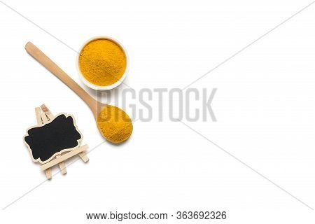 Dried Turmeric Powder In Bowl And Wooden Spoon Curcumin , Yellow Ginger Isolated On White Color Back