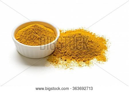 Orange Dried Turmeric, Curcumin , Yellow Ginger Powder In White Glass Bowl Isolated On White Color B