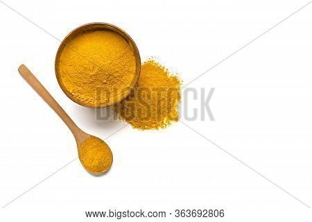 Dried Turmeric Powder In Wooden Bowl And Wooden Spoon Curcumin , Yellow Ginger Isolated On White Col