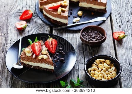 Vegetarian Dessert Chocolate Tart Of Two Layers Made Of Coconut Cream And Soaked Cashews With The Cr