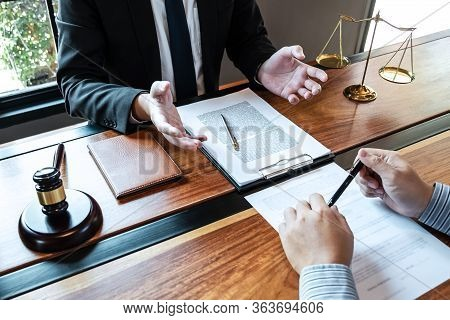 Professional Male Lawyer Or Counselor Discussing Negotiation Legal Case With Client Meeting With Doc