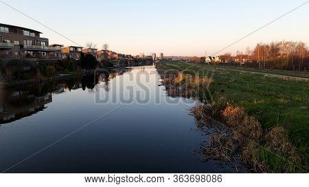 The Sun Rises Over The Ring Canal Of The Zuidplaspolder In The Town Of Nieuwerkerk Aan Den Ijssel In