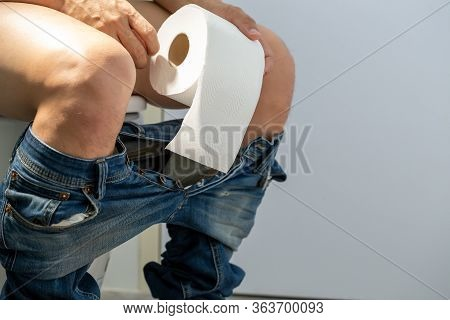 Men Entering The Toilet And Rectal Bleeding Concept, Symptom Of A Serious Disease Such As Colorectal