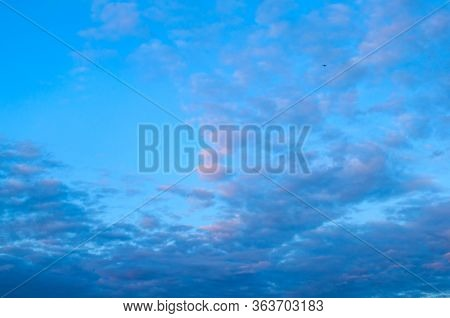 Blue sky background. Picturesque colorful clouds lit by sunlight. Vast sky landscape panoramic scene - colorful sky view in soft tones.Vast sky landscape panoramic scene, blue sky landscape. Colorful sky view, vast sky background. Blue sky scene