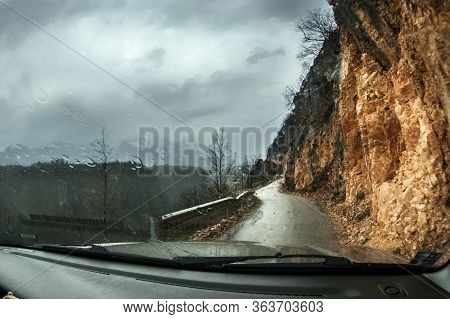 Dangerous Mountain Road In The Balkans. On The Right-a Steep Slope, On The Left-a Cliff. Raindrops O