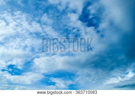 Blue sky background. Picturesque clouds lit by sunlight. Vast sky landscape panoramic scene. Vast sky landscape panoramic scene, blue sky landscape. Colorful sky view, vast sky background. Blue sky scene