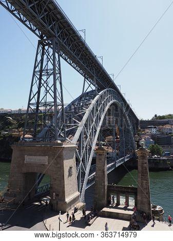 Double-deck Iron Bridge Over Douro River In Ribeira Area In European Porto City In Portugal, Clear B
