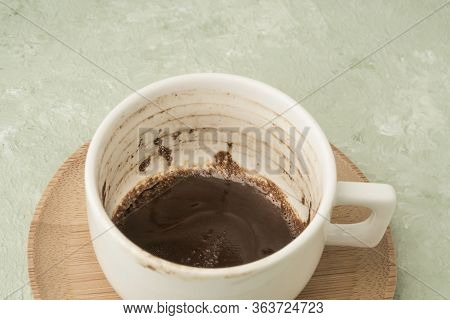 A Cup Of Coffee With Grounds