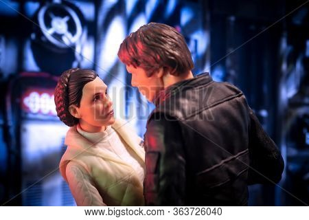 APRIL 26 2020: recreation of a scene from Star Wars The Empire Strikes Back where Han Solo embraces Princess Leia Organa aboard the Millenium Falcon - Hasbro Action Figure