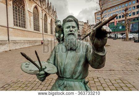 Brussels, Belgium: Portrait Of The Famous Artist Pieter Bruegel The Elder In Bronze Statue, Flemish