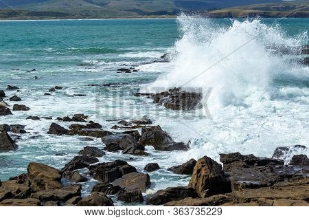 Waves Crushing At Rocks In Porpoise Bay Of New Zealand On A Stormy Day, Waikawa, New Zealand