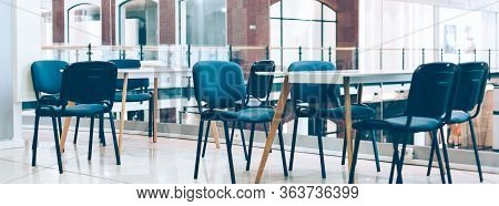 Informal Coworking Room Space For Creative Freelancers With Tables And Chairs. Comfortable Contempor