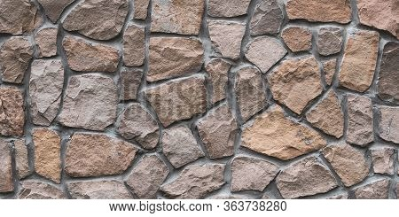 Brown Stone Wall Texture, Floor Background. Wide Panoramic Rock Pattern. Natural Masonry Surface, Br
