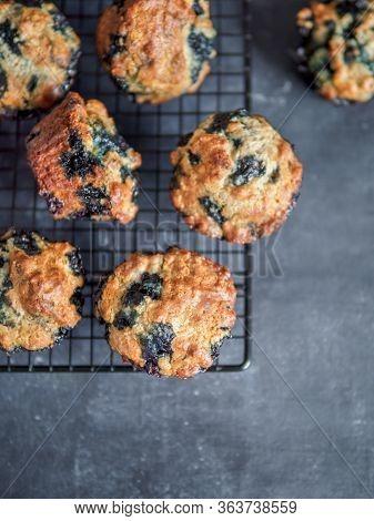 Homemade Vegan Blueberry Muffins On Cooling Rack. Vegetarian Egg-free Muffins On Dark Background. Ve