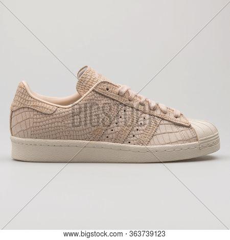 Vienna, Austria - February 19, 2018: Adidas Superstar 80s Linen Sneaker On White Background.
