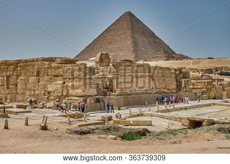 Tourists Visiting The Giza Plateau With The Great Sphinx And The Giza Pyramid Complex In Cairo, Egyp