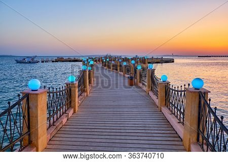 View Of The Promenade Boardwalk Over The Red Sea During Sunrise In Hurghada, Egypt