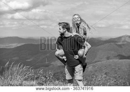 Beautiful Couple Embracing Landscape Background. Journey To Mountains Concept. Honeymoon In Highland