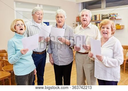 Seniors from the senior choir sing together at the choir rehearsal in the retirement home