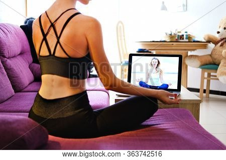 Woman Sit In Lotus Pose Meditating Using Notebook On-line Yoga Session