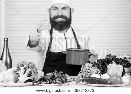 Use Hand Whisk. Professional Chef Hold Whisk And Pot. Whipping Like Pro. Man Bearded Guy In Apron Wh