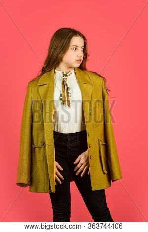 Oversize Concept. Trench Coat Fashion Trend. Fashionable Coat. Little Girl Posing Jacket Coat With C