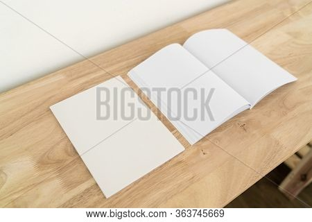 Blank catalog, magazines, book, mock up on wood background.