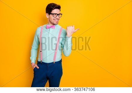Photo Of Handsome Trend Outfit Business Guy Thumb Finger Directing Side Empty Space Showing Novelty