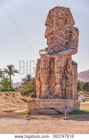 Colossi Of Memnon, Massive Stone Statues Of The Pharaoh Amenhotep Iii In The Valley Of Kings, Luxor,