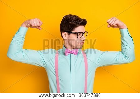 Portrait Of Unsure Disappointed Upset Guy Look At His Biceps Dislike Bodybuilding Workout Sport Trai