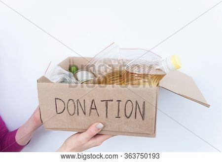 Volunteer Holding Food Donation Box. Support Food Banks Concept. Funds And Donations. Charity Donati