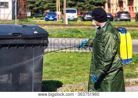 Disinfection Coronavirus Outside By Man In Protective Suit