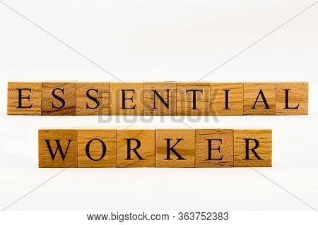 Coronavirus Concept Showing Wooden Blocks On A White Background Reading Essential Worker