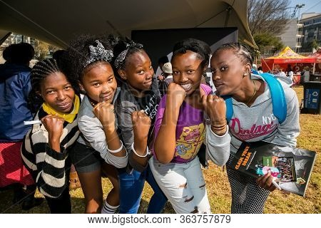 Group Of Young African Girls Flexing Arm Muscles In Show Of Feminist Power