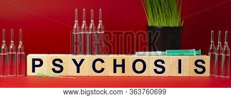 Psychosis Is Written On Wooden Cubes. And Substantiation Of Medicines. Mixed Therapy Drugs And Docto