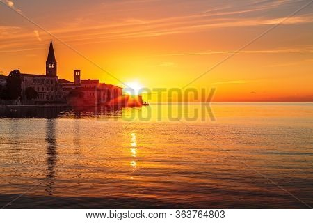 View On A Historic Center Of Porec Town And Sea At Sunset, Croatia, Europe.