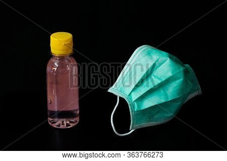 Surgical Mask (doctor) With Hand Wash Gel Isolated On Black Background - For Prevent Dust (pm 2.5),