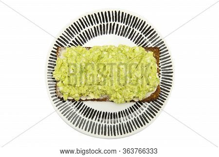 Top View Of Healthy Sandwich With Fresh Avocado And Boiled Eggs Paste On Plate Isolated On White Bac