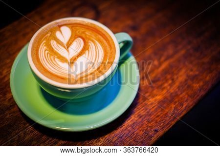 Homemade Hot Fresh Cocoa (coffee Or Latte) With Pattern White Milk Froth On Surface In Cup With Wood