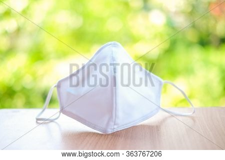 Cloth White Mask Isolated On Nature Background - For Prevent Dust (pm 2.5),  Disease (coronavirus Or