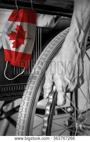 Senior In Wheelchair At Nursing Home In Black And White With Hanging Canadian Flag Face Mask In Colo