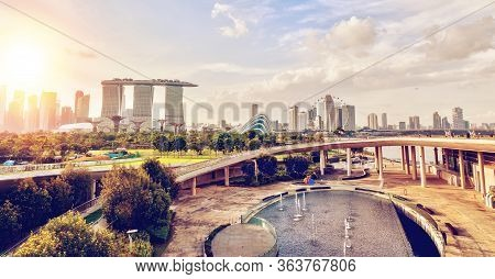Sunset Panorama Of Singapore Skyline From The Marina Barrage. The Barrage Is A Reservoir Dam In The