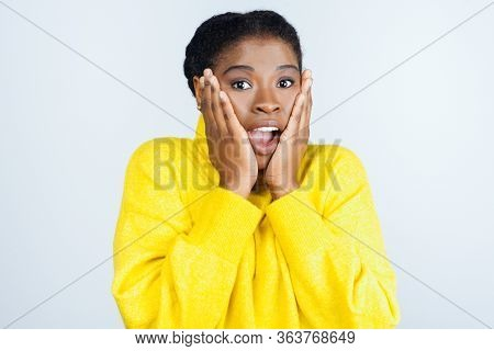 Shocked Young Woman Looking At Camera. Portrait Of Scared Young African American Woman Holding Hands